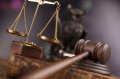Чиновник лишится кресла на 12 лет за крупную взятку